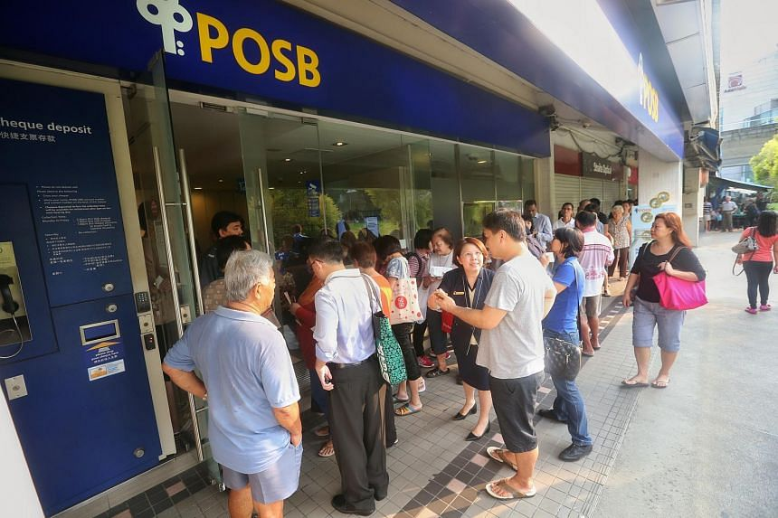 People queueing up for the SG50 commemorative notes at POSB's Tampines Central branch on Aug 20, 2015.
