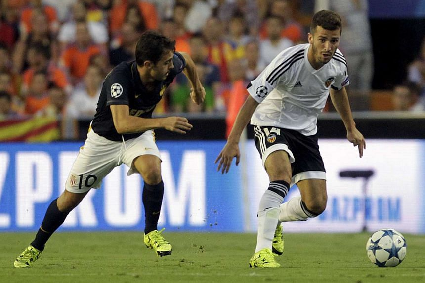 Valencia's Jose Gaya (right) and Monaco's Bernardo Silva fighting for the ball during their Champions League play-off first leg football match at the Mestalla stadium in Spain.