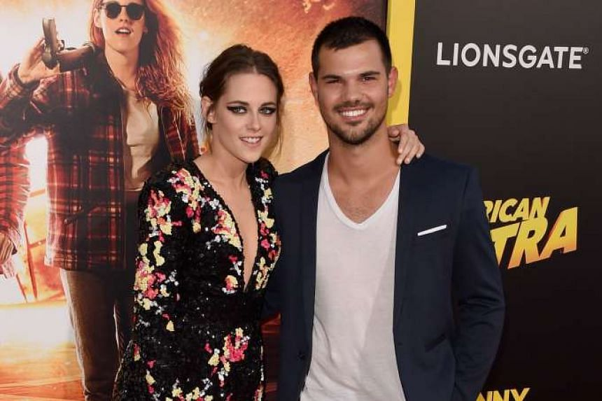 Former Twilight stars Kristen Stewart and Taylor Lautner (both above) reunited on the red carpet on Tuesday for the Los Angeles premiere of American Ultra. Stewart stars in the thriller, opening in the United States tomorrow, with Jesse Eisenberg, Co