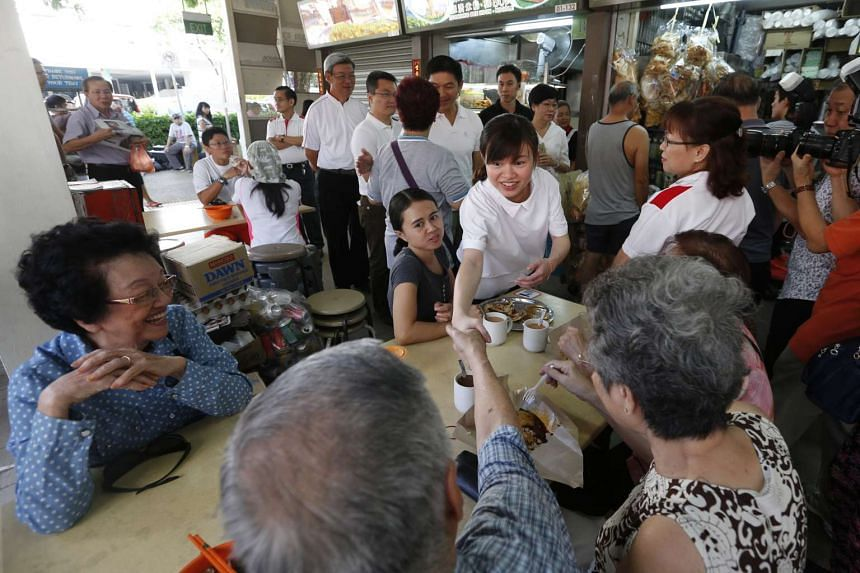 Ms Tin Pei Ling during a walkabout in Macpherson Block 89 Market on July 27, 2015.