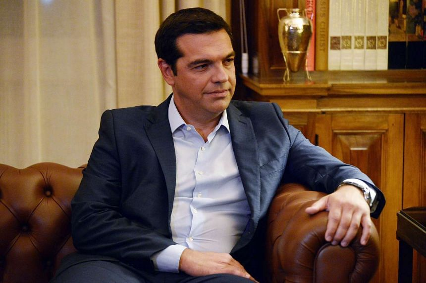 Greek PM Alexis Tsipras presenting his resignation to the Greek president (unseen) at the presidental palace in Athens on Aug 20, 2015.