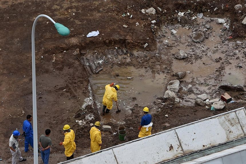 Workers removing water polluted by chemicals from the site of explosions in Tianjin last week. However, although cyanide levels in the river, sea and waste water in the evacuated area have risen sharply since the deadly blasts, drinking water in Tian
