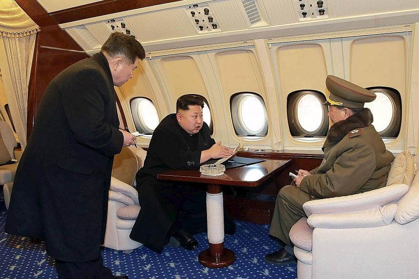 North Korean leader Kim Jong Un sitting in the cockpit of a plane (top), taking flight at a machine plant (above) and on board his plush jet.