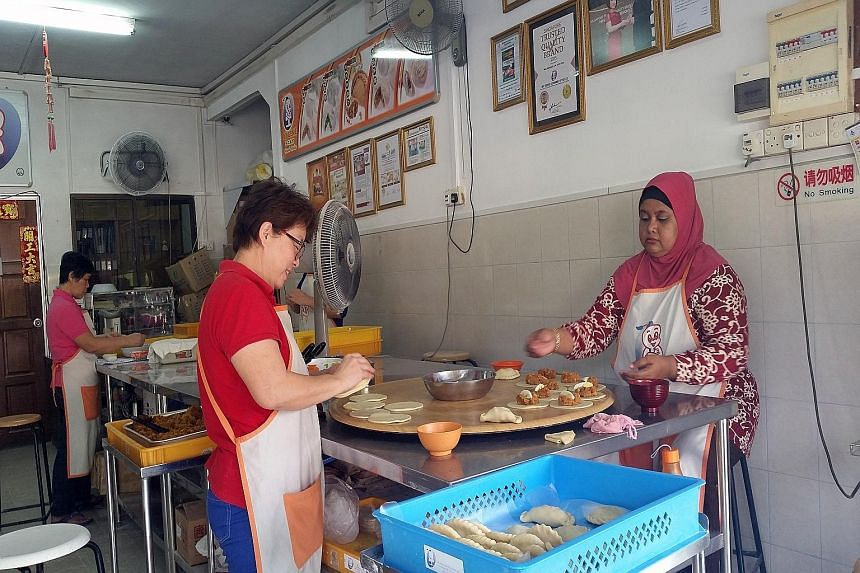 A visit to the sand depository on Pulau Punggol Timor. Long Tien takes visitors to My Genie Gourmet factory in Hougang, which produces local snacks such as mini soon kueh and curry puffs. The offbeat tours by Tribe include visiting a coffee-roasting