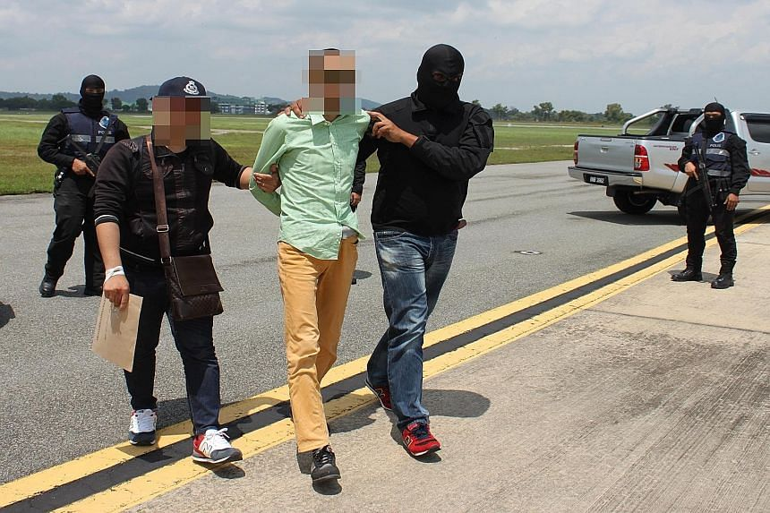 The six security personnel were arrested along with four others in a sting operation conducted across six states on Wednesday, said the Royal Malaysian Police. They are suspected of planning to obtain weapons to launch terror attacks.