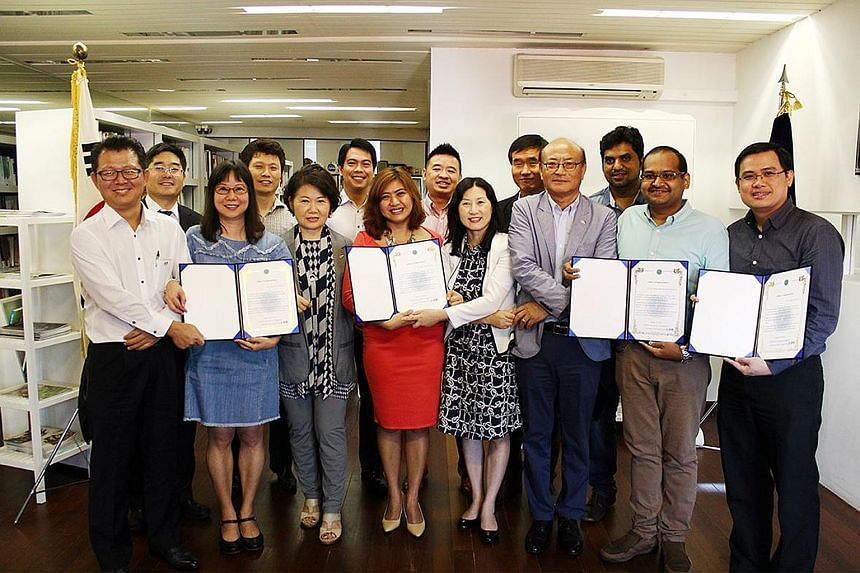 Korean Association chairman Noh Chong Hyun (front row, third from right) and association staff with some of the rescuers who helped accident victim Kim Sung Mo.