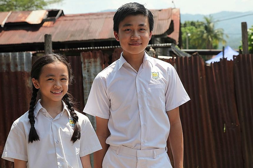 Jack Neo's That Girl (above, starring Yan Li Xuan and Josmen Lum) is an achingly bittersweet depiction of a childhood crush, featuring a kampung setting and a cast with a large number of speaking parts.