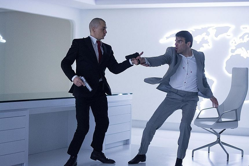 Agent 47 (Rupert Friend, far left) squares off against assassin John Smith (Zachary Quinto) in Hitman: Agent 47.