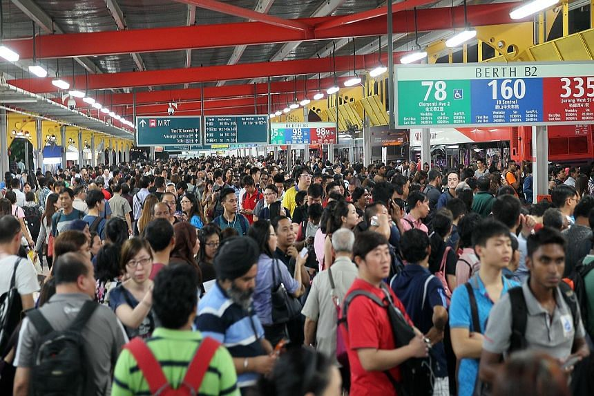 Crowds at the Jurong East bus interchange on July 7, when the North-South and East-West MRT lines broke down. The Defence Ministry says that the Singapore Armed Forces will work with the Land Transport Authority in the event of a major rail disruptio