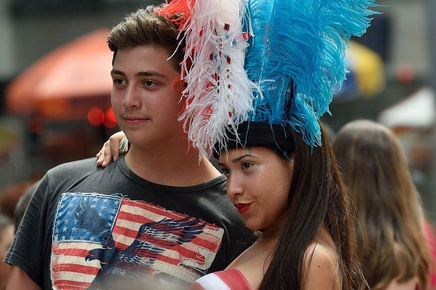 They call themselves street entertainers but some women in New York City's Times Square are appearing with just body paint over their ample bosoms to pose for photos with tourists for money. Governor Andrew Cuomo wants a crackdown on the nearly naked