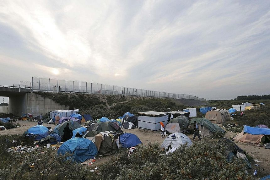"A makeshift camp for migrants called ""The New Jungle"" in Calais. Some 3,000 people from Africa, the Middle East and Asia are camped out in the French port city, waiting for a chance to cross over into Britain."
