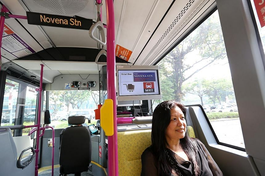 Officer manager Phyllis Chng, 62, gave her feedback on the passenger information display (above her) on trial in buses.