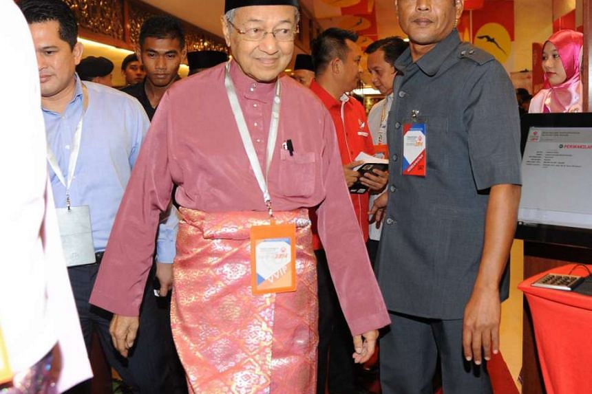 Former Malaysian leader Mahathir Mohamad calls for an immediate vote of no-confidence against Prime Minister Najib Razak. --