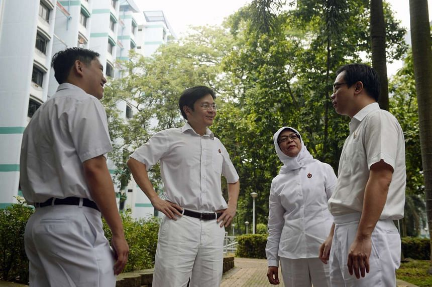 The PAP's team for the new Marsiling-Yew Tee GRC (from left) Alex Yam, Lawrence Wong, Halimah Yacob and Ong Teng Koon.