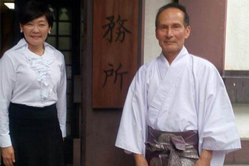 Mrs Akie Abe, wife of Japanese Prime Minister Shinzo Abe, posted on her Facebook page a picture of herself standing next to a senior priest during a visit at Yasukuni shrine in Tokyo on Aug 18, 2015.