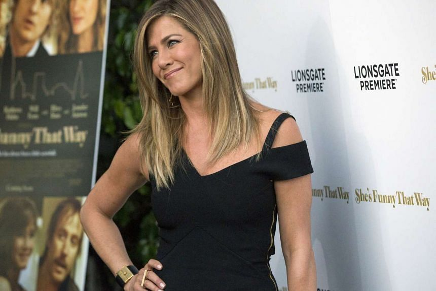 Jennifer Aniston posing at the premiere of She's Funny That Way in Los Angeles.