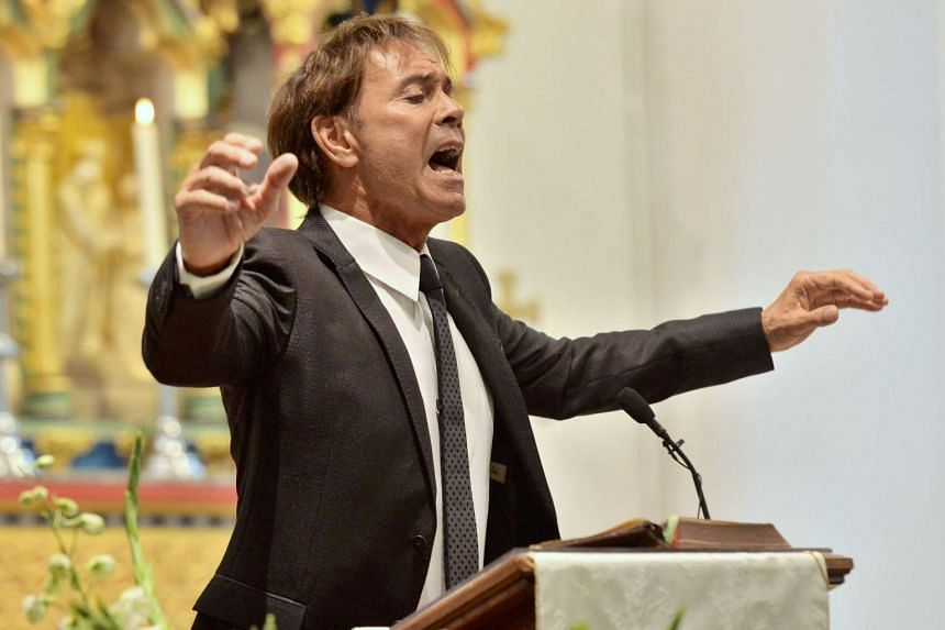 Pop star Cliff Richard sings at the funeral of Cilla Black at St Mary's Church in Liverpool, Britain, on Aug 20, 2015.