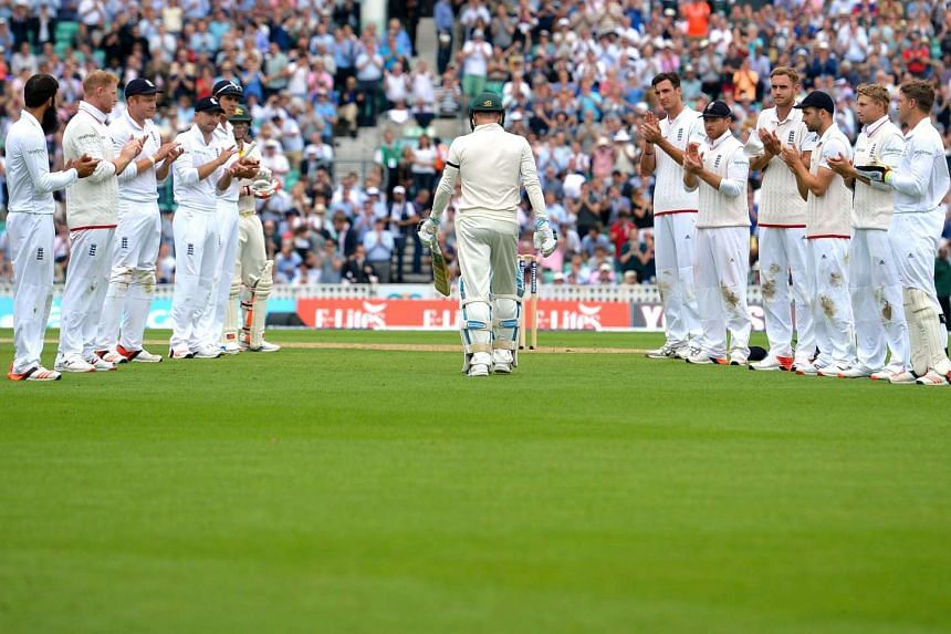 The England team marking Australia captain Michael Clarke (centre) with a guard of honour during the Ashes finale at The Oval on Thursday.