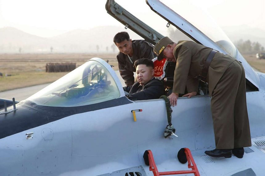 North Korean leader Kim Jong Un sitting in an airplane as he guides a flight drill for the inspection of airmen of the Korean People's Army Air and Anti-Air Force in this undated file photo released by North Korea's Korean Central News Agency on Oct