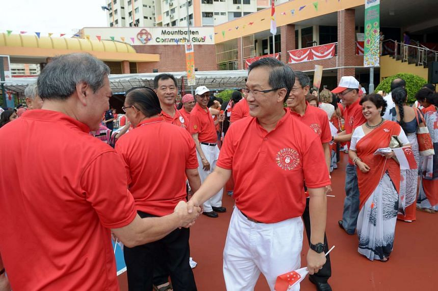 Lim Biow Chuan (right) greeting Mountbatten residents at his ward's National Day observance event.