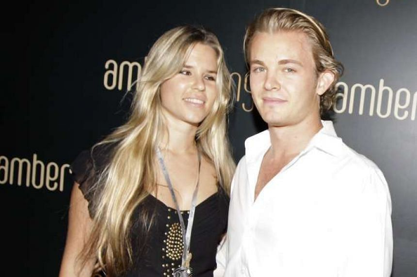 Rosberg and then girlfriend Vivian, who is due to give birth to a daughter.
