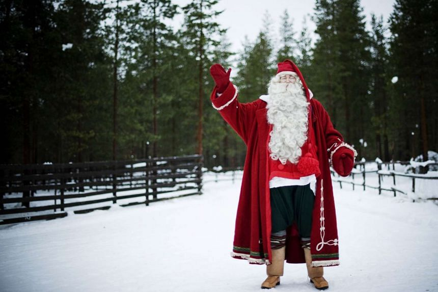 A 2011 file photo shows Santa Claus posing at Rovaniemi, in Finnish Lapland.