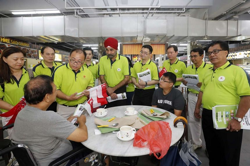 Members of the Singapore Democratic Alliance distributing party leaflets during its walkabout in Sengkang on Aug 1, 2015.