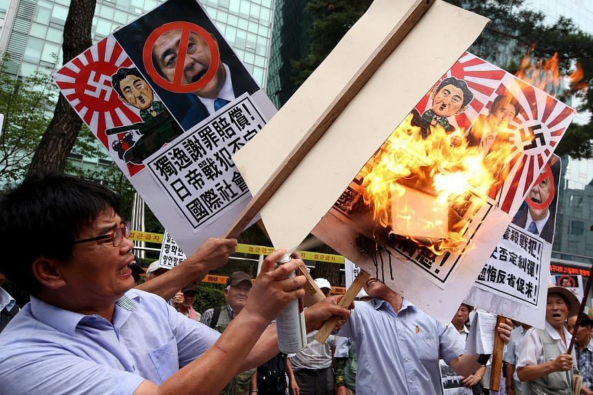 South Korean protesters during a protest rally near the Japanese embassy in Seoul, South Korea on Aug 15, 2015.