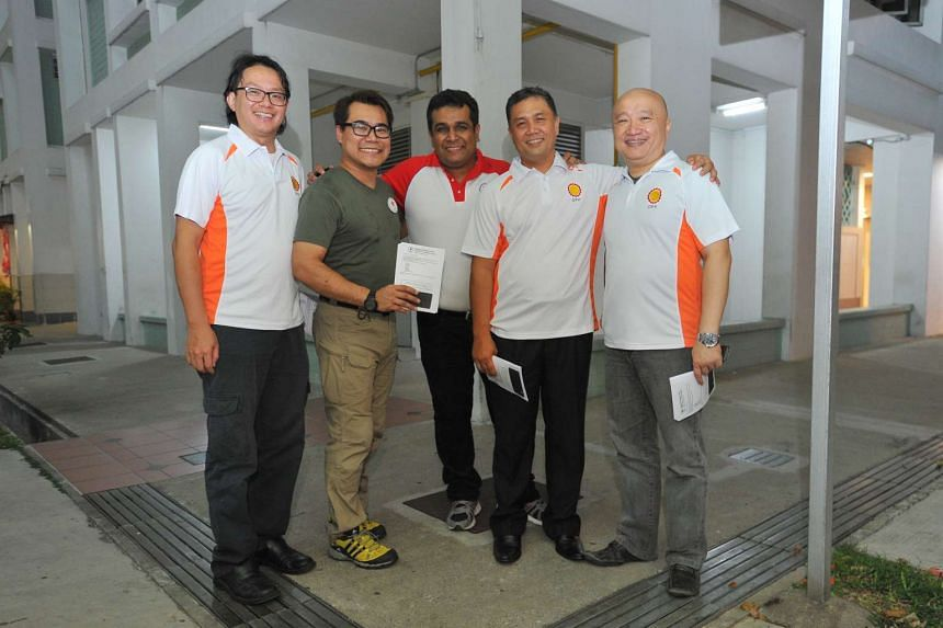 From left: Mr Robin Low, SPP volunteer, Mr Eman Lim, SPP member, Mr Ravi Philemon, SPP member, DPP chairman Mohamad Hamim Aliyas and DPP secretary-general Benjamin Pwee, below Blk 86, Toa Payoh Lorong 2 on Aug 20, 2015.