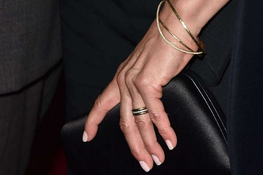 Actress Jennifer Aniston, 46, flashed her gold- and-diamond wedding ring in her first public appearance since marrying actor Justin Theroux on Aug 5.