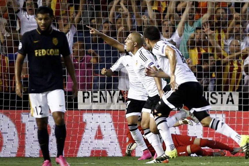 A late strike by Sofiane Feghouli (centre) gave Spanish side Valencia a two-goal cushion heading into next week's Champions League play-offs second leg against French side Monaco.