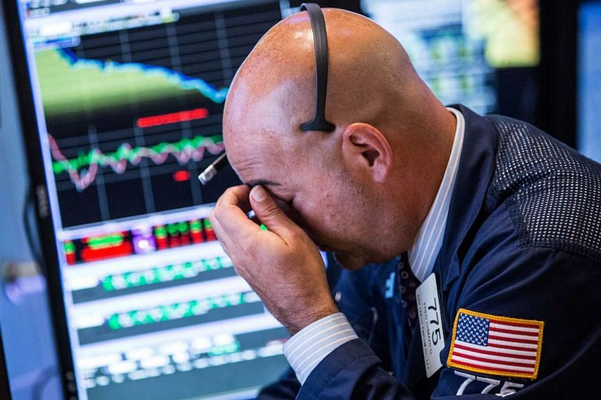 A trader on the floor of the New York Stock Exchange on Aug 20, 2015, in New York City.