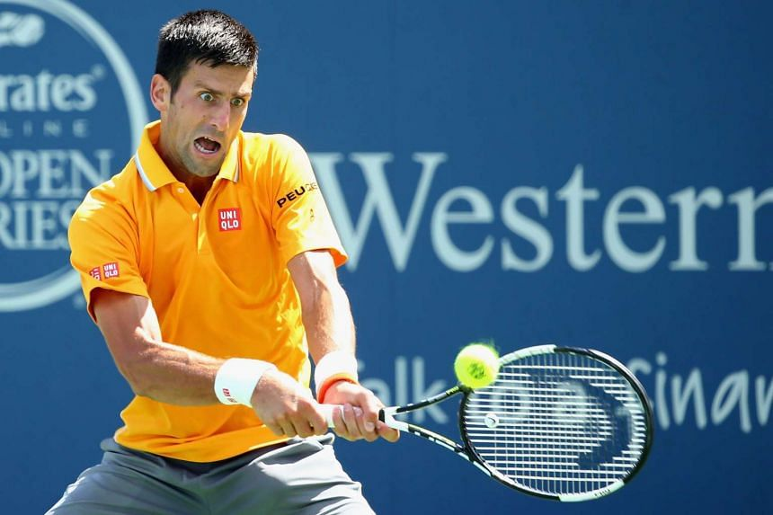 Novak Djokovic of Serbia returns a backhand to David Goffin of Belarus at the Western & Southern Open on Aug 18, 2015, in Cincinnati, Ohio.