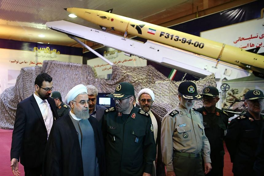 Iranian President Hassan Rouhani(2nd left) unveilling the surface-to-surface 313 missile on Aug 22, 2015.