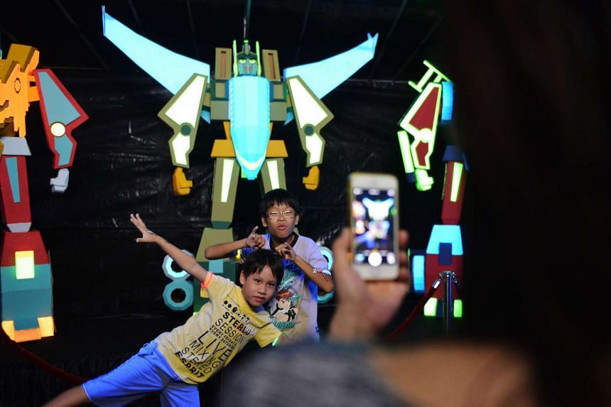 Jaden Koh (left), seven, and Justin Koh, 10, posing with the LumiArt installation.