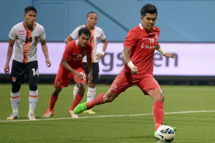 Khairul Amri scoring the LionsXII's second from the penalty spot.