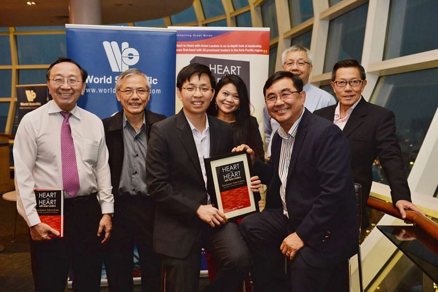 Book authors, Alvin Foo (third from left) and John Ng (3rd from right) and some of the book contributors (from left) Lim Hua Min, Associate Professor Ho Peng Kee, Jocelyn Chng, Edward Ong and James Chia at the book launch of Heart to Heart with Asian