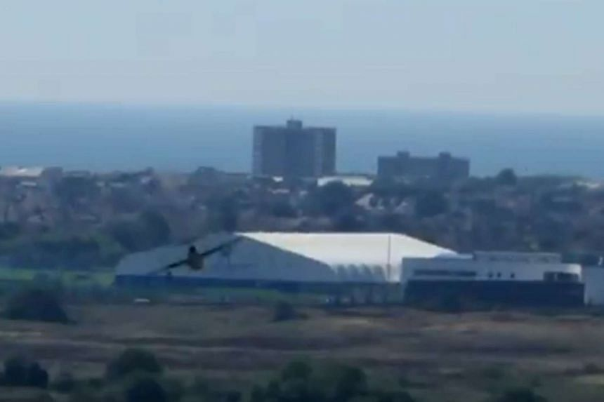 A screengrab from a YouTube video showing the plane crash in Shoreham.