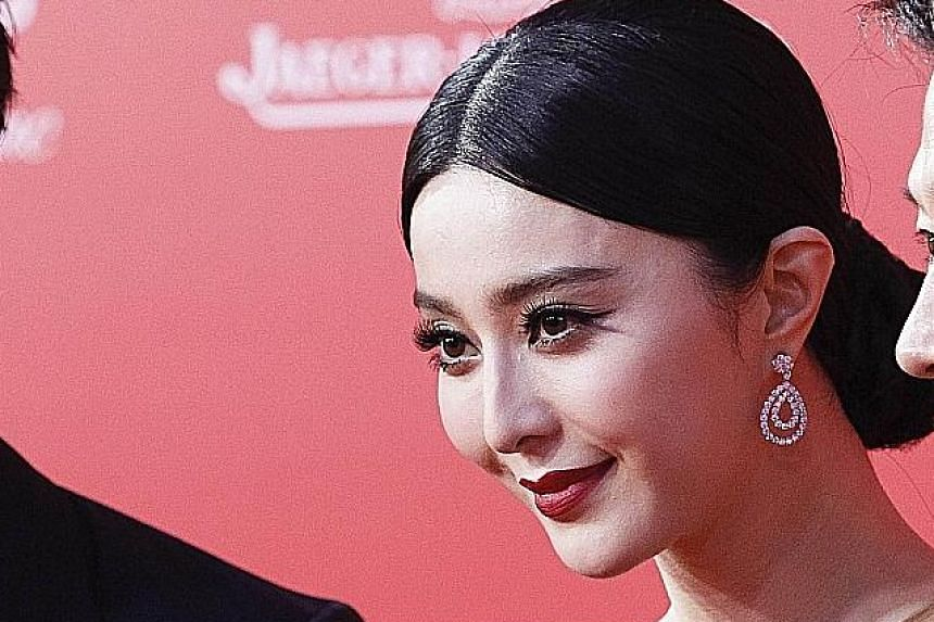 Hunger Games star Jennifer Lawrence (left) made $73 million last year and Chinese actress Fan Bingbing (above), the only Asian on the list, raked in $29.5 million.