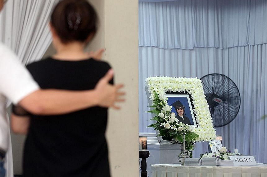 """At the wake of Ms Melisa Liu Rui Chun at her home in New Upper Changi Road, her mother Katherine Woo, who had just lost her husband to cancer in June, said: """"It's very heartbreaking. Now she's gone, it's so painful, so painful."""" Ms Liu's husband Ng S"""