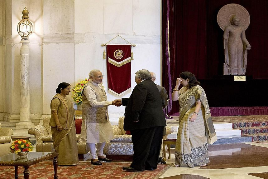 Indian Foreign Minister Sushma Swaraj (at far left) looking on as Prime Minister Narendra Modi welcomed Samoa's Premier Tuilaepa Lupesoliai Sailele Malielegaoi to the Presidential Palace yesterday. New Delhi is hosting the heads and representatives o