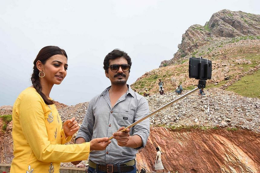 Actors Radhika Apte and Nawajuddin Siddique at a promotion for Manjhi - The Mountain Man, based on the true story of an Indian man who spent 22 years chiselling a path through a mountain to reduce the distance from his village to town, after his wife