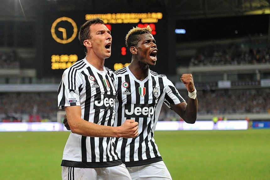 """Mario Mandzukic (left) of Juventus celebrates with Paul Pogba after scoring during the Italian Super Cup win over Lazio earlier this month. Club CEO Beppe Moratta says Juve """"can't be anywhere else but on top""""."""