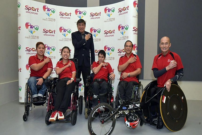 From left: Theresa Goh (swimming), Jeralyn Tan (boccia), Lim Teck Yin, chairman of the Sapgoc executive committee, Neo Kah Whye (boccia), Eugene Soh (table tennis) and William Tan (athletics). Singapore will field a record 145-strong team in the Asea
