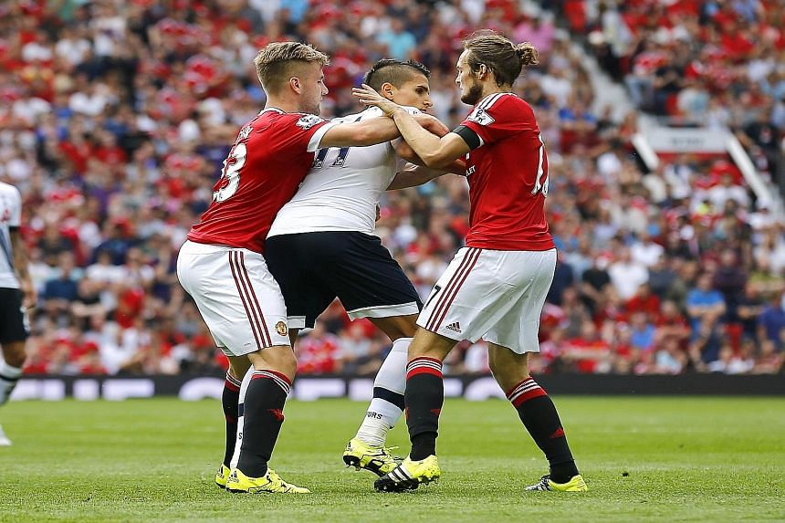 Manchester United giving Tottenham winger Erik Lamela (centre) a taste of their double team of Daley Blind (right) and Luke Shaw. Such cohesiveness at the back saw United chalk up two straight league clean sheets.