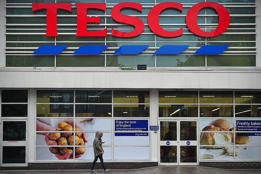 """A Tesco supermarket in London. Britain's largest grocer was rocked by an accounting debacle last year. The fallout and declining sales saw its credit rating slashed to """"junk"""" status in January. Selling its South Korean unit, valued at around $8 billi"""