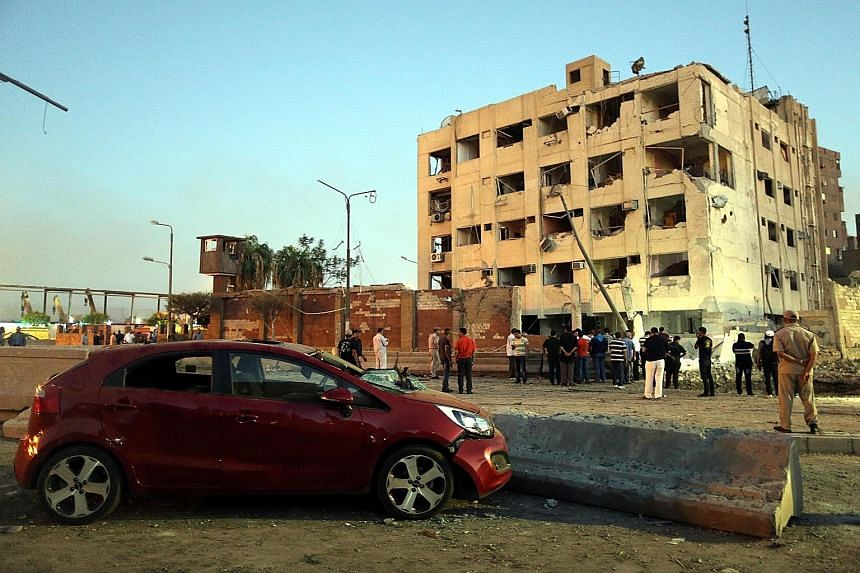 The scene where a bomb blew up next to a national security building in Cairo on Thursday, wounding at least 29 people. Militants claiming to be part of ISIS have taken responsibility for the attack.