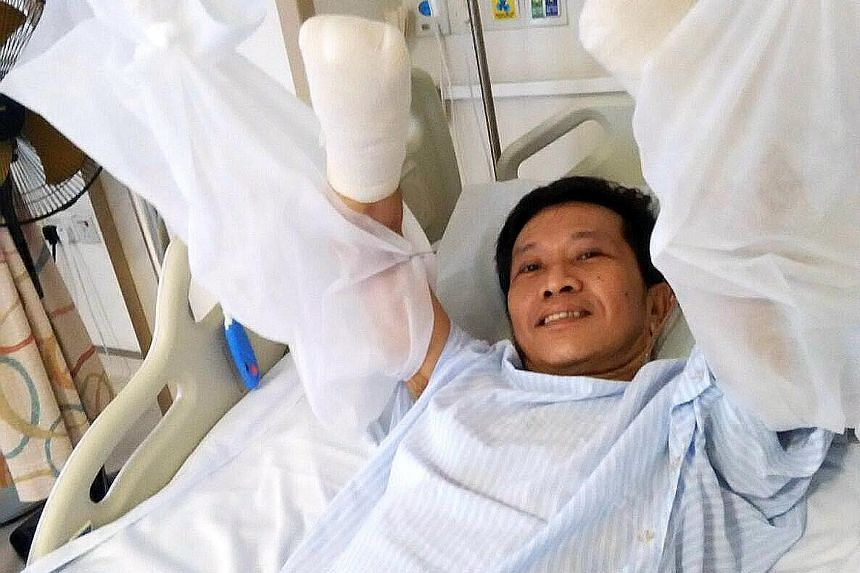 Mr Tan Whee Boon in good spirits after surgery yesterday. The food poisoning led to medical conditions requiring his hands and feet to be amputated.