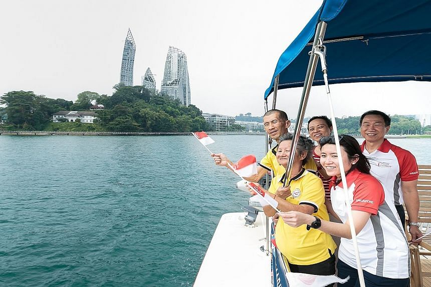 Senior citizens from Thye Hua Kwan (THK) Moral Activity Centre taking in the sights of Singapore's southern shores on a cruise yesterday organised by Marina at Keppel Bay. Joining the seniors were Keppel Volunteers and Keppel Land senior management i