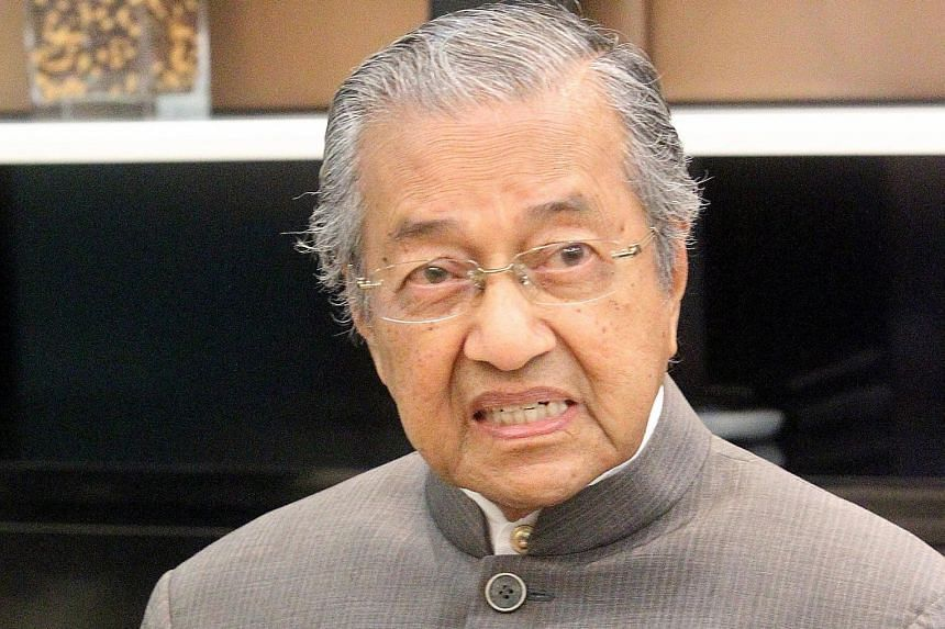 """Malaysian Prime Minister Najib Razak (left) says that no individual, """"however eminent"""", should interfere with his mandate to rule. His remark appears to be targeted at his harshest critic, former premier Mahathir Mohamad (below, left)."""